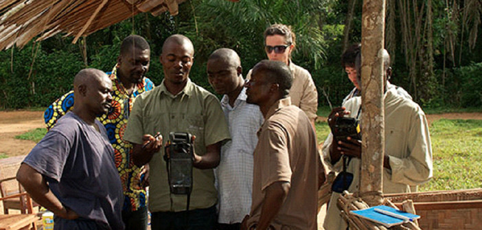 AWF Biologist Alain Lushimba (centre) trains protected area practitioners on the use of the CyberTracker bio-monitoring tool. Photo: Johannes Refisch/GRASP