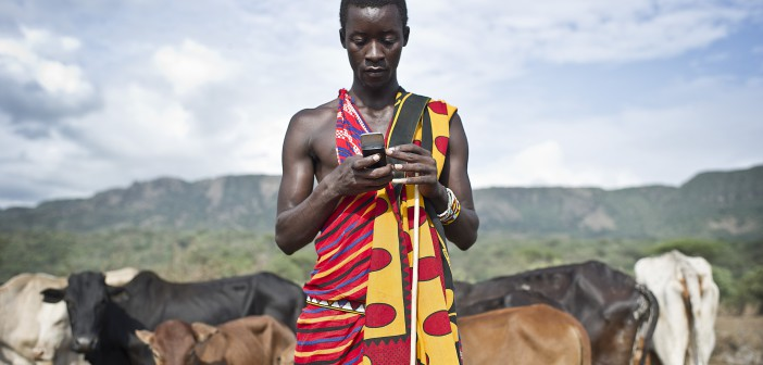 Isaac Mkalia, 20 years old, a teacher by profession checks his mobile phone. Increasing numbers of smartphones across the continent are giving Africans greater access to the Internet – and to global music.