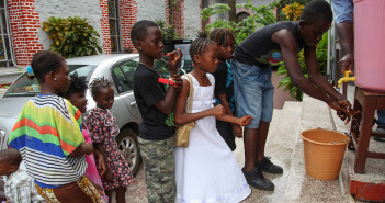Liberian children wash hands before entering a church service to pray for the end of Ebola at the Providence Baptist Church in Monrovia, Liberia, August 3, 2014.(Ahmed Jallanzo/EPA) #