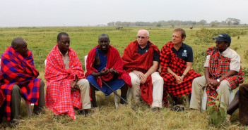 IFAW's James Isiche, Azzedine Downes, Perry Sonntag and Steve Njumbi talk with Mr. Daniel Leturesh at a traditional Lomon leader's meeting.