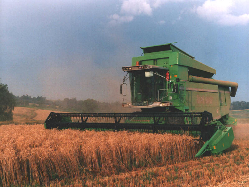 In the South African context, the agricultural sector is a critical stakeholder in the management of our natural resources, with 80% of the land surface owned by agriculture (including small-scale farmers, emerging farmers and commercial farmers). Photograph: Combine Harvester by Walter Wölfel / Wikimedia Commons.